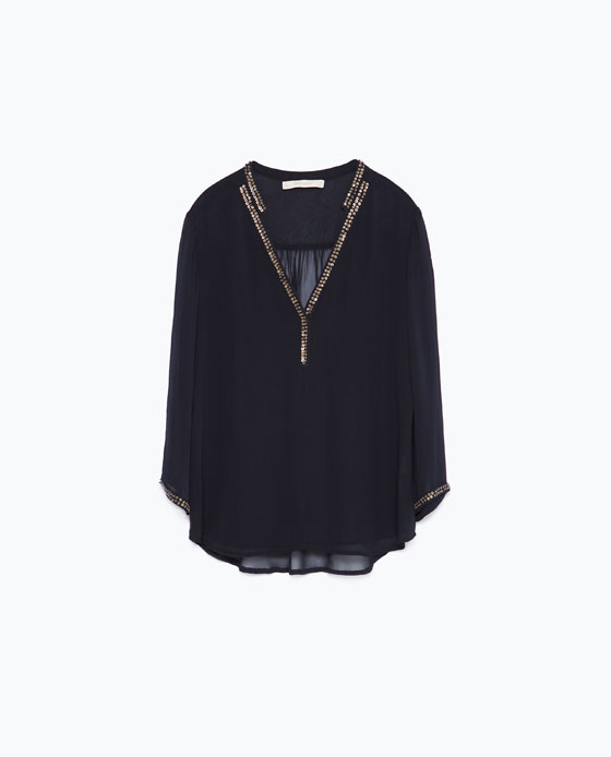 Navy blue blouse with beaded neck detail