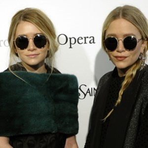 Mary-Kate and Ashley Olsen wearing round sunglasses