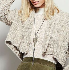 Cropped knit cardigan is almond beige color