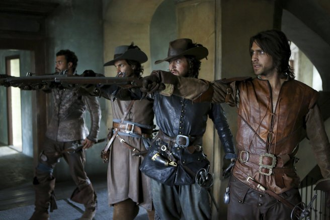 The Musketeers BBC holding pistols-revolvers